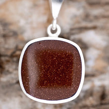 Load image into Gallery viewer, Goldstone and Jet Reversible Pendant