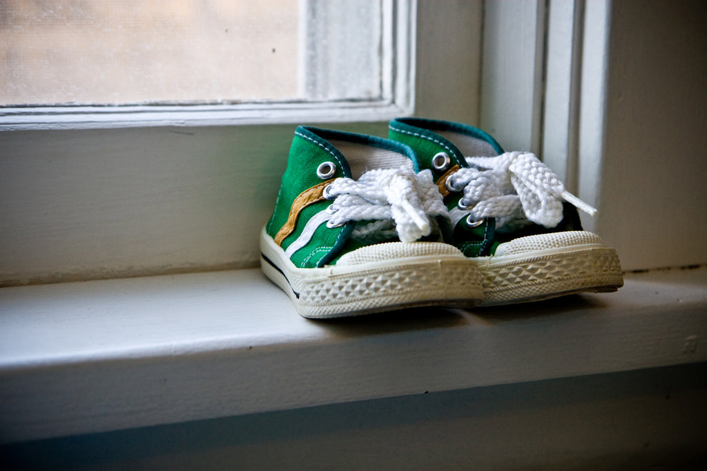 Baby shoes in window sill