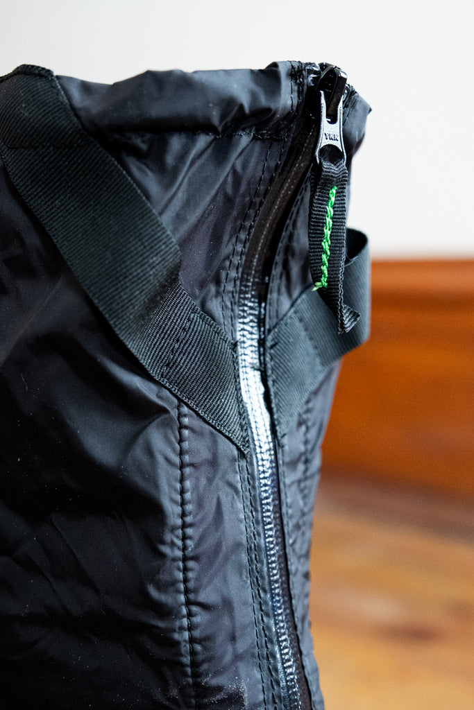 close up of zipper of TUKX OverShoe Backzip