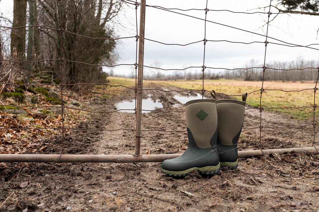 Kids Muck boots by muddy country road