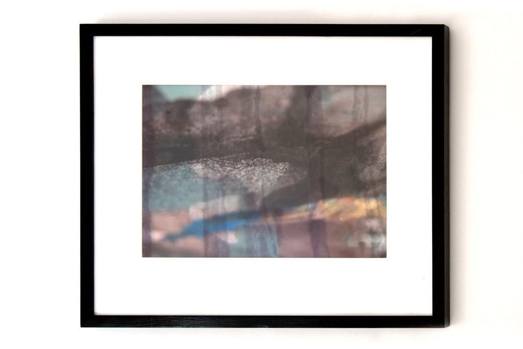 This is a photo of the print in the frame. The insert is white with a black frame around it. By Danielle Jacques.