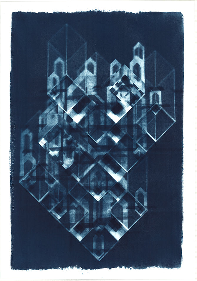 Abstract blue cyanotype. Dark blue background with an abstract design made up of multiple 3D white blocks, some of the edges are really sharp and others appear blurred. By artist Eleanor Suess