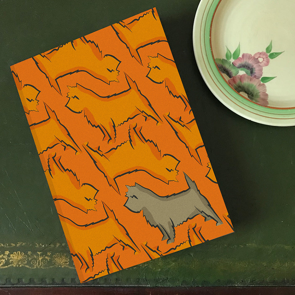Orange background with repeated terrier print with statement grey terrier. By Lydia Jones