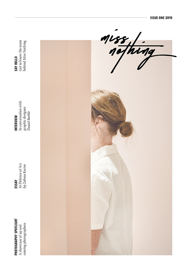 Front cover of the miss Nothing Magazine. There is text going up on the left hand side, but most of the cover is taken up by a photograph of a woman wearing a white shirt walking to the left, with her face obscured. By Karolina Gliniewicz.