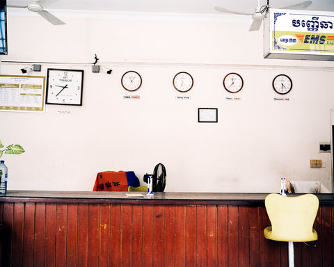 Sophia Wöhleke's photo depicting the inside of a post office in either France, Italy, Cambodia or Thailand, pale pink walls and wooden desk it looks very retro in style.