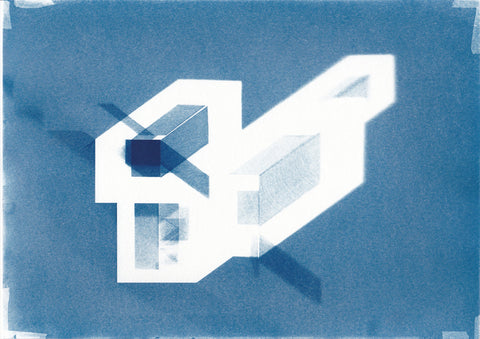 "Cyanotype print of blueprint architectural ""axonometric"" drawings.  The image depicts one acrylic cuboid blocks with shadows and reflected light of each unique arrangement. The colours in the print are blue and white. By Eleanor Suess."