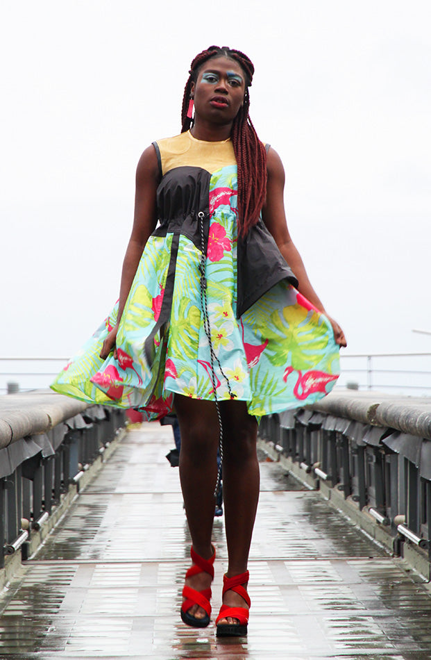 Sleeveless, knee length dress with adjustable waistline, made from a colourful print of flowers, leaves and flamingos. Created from an upcycled tent. Piece by Amber Kim