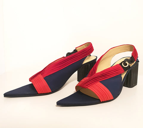Elegant navy blue court shoes, with sewn red pleated detail, and hook fastening. Created from an upcycled tent. Piece by Amber Kim