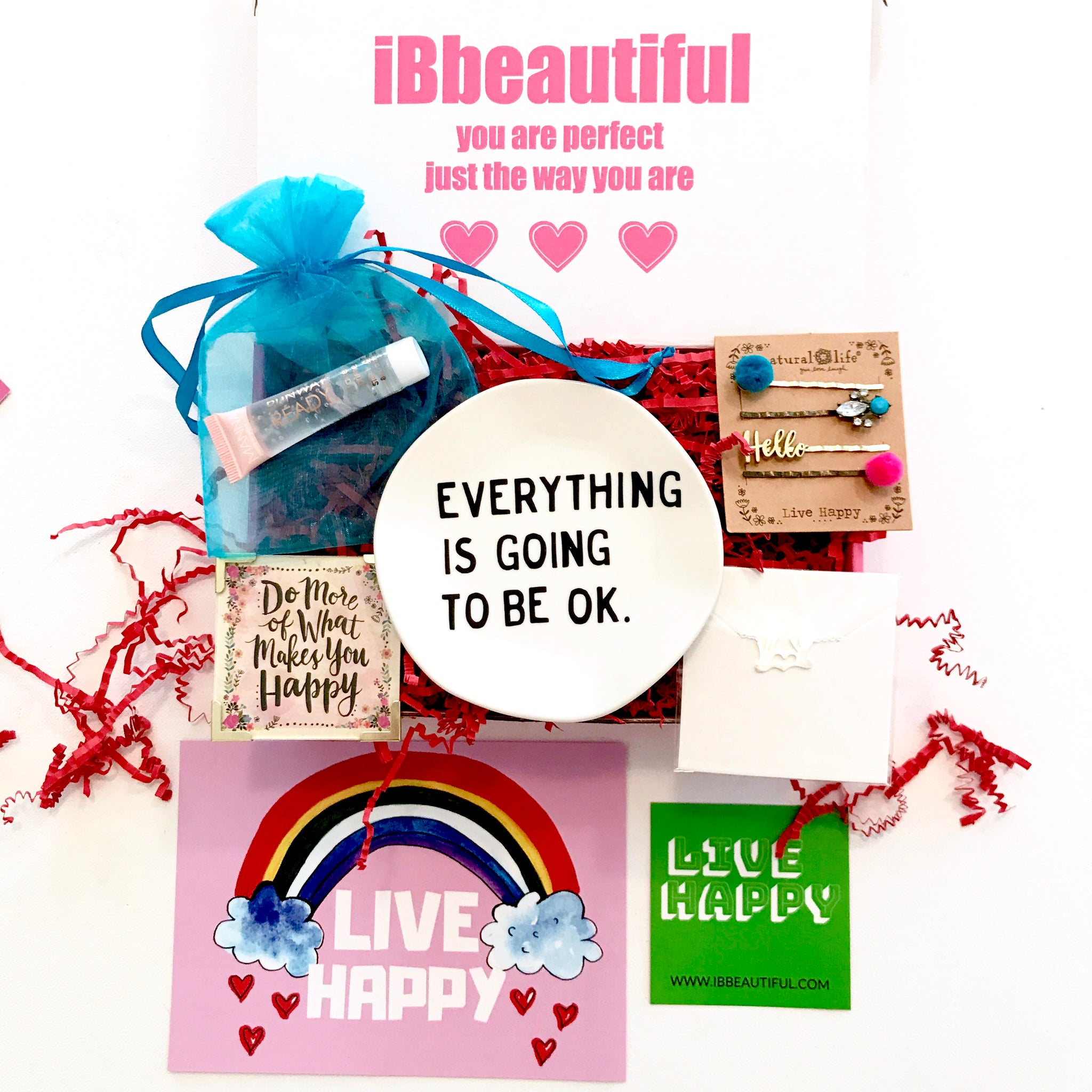 ibbeautiful live happy box contents hair clips, necklace, magnet, sequins