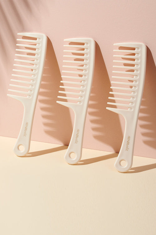 The Hair Edit White Tame & Condition Detangling Shower Comb For Wet & Dry Hair display of 3 standing combs