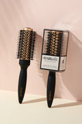 The Hair Edit round ceramic vented barrel blowdry & shine black & gold brush display