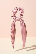 The Hair Edit blush pink pleated ribbon scrunchie hair bow accessory on display