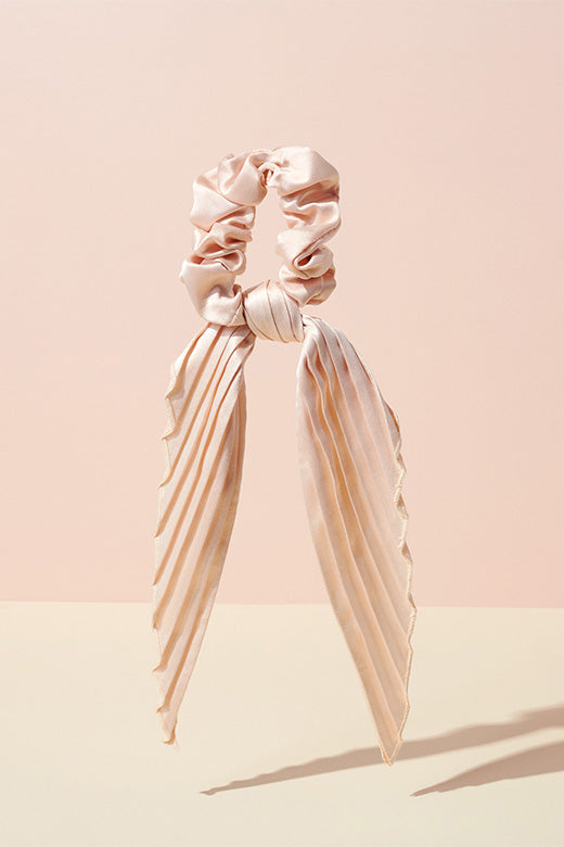 The Hair Edit cream colored pleated ribbon scrunchie hair tie