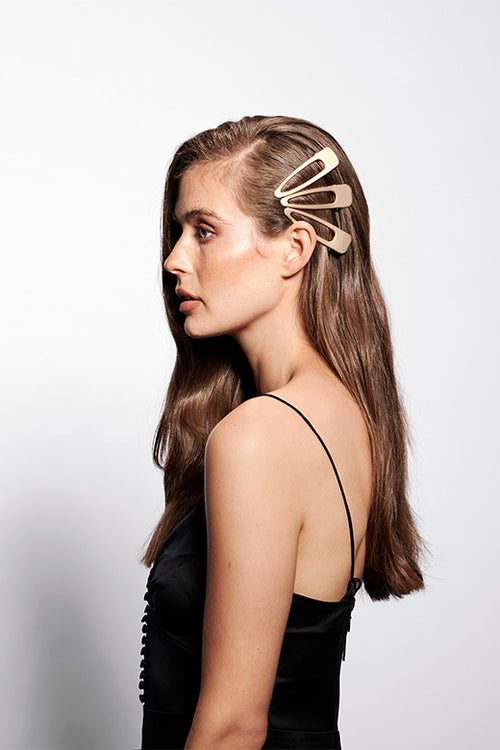 The Hair Edit Soft Gold Brushed Triangle Hair Clips on Brunette Model