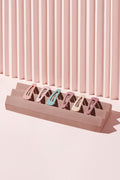 The Hair Edit Pastel Colored Matte Snap Triangles Hair Clip Accessories on pink display