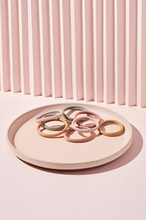The Hair Edit gilded threads gold accented set of four hair ties on pink display plate