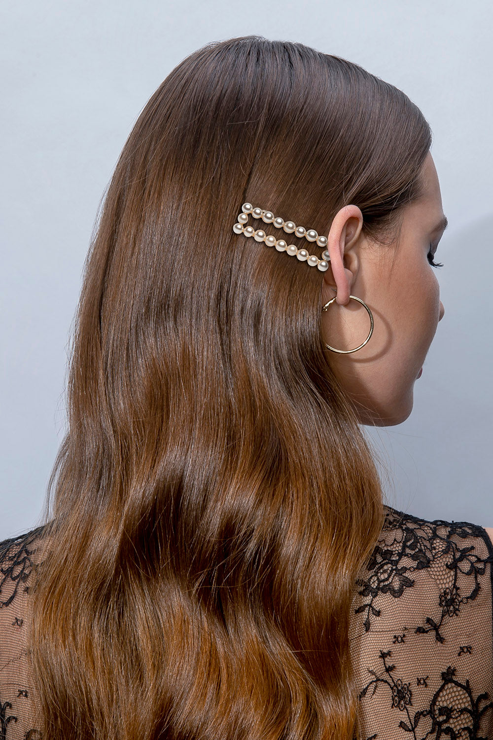 Light Brunette Female Wavy Long Haired Model wearing The Hair Edit's Pearl Square Gold Jeweled Clip Hair Accessory