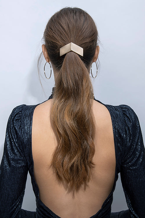 The Hair Edit Soft Gold Chevron Hair Cuff Geometric Metal Hair Tie Accessory worn by long haired brunette model with ponytail