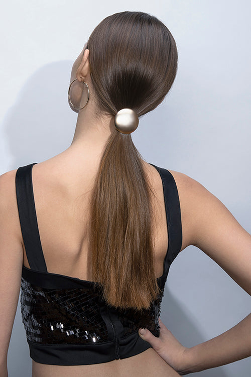 The Hair Edit Soft Gold Royal Disk Circular Metal Hair Tie worn by blonde long haired female model with ponytail