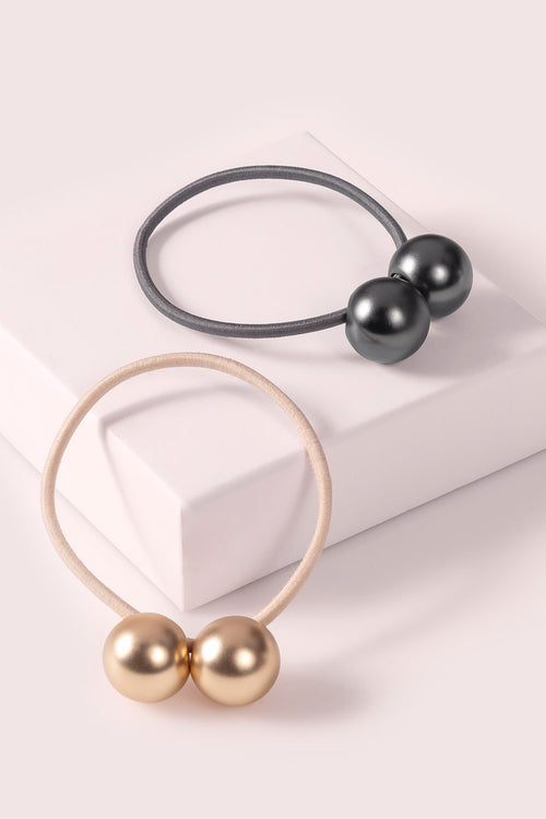 The Hair Edit Orb Duo Ponytail Holder Dual-Sphere Metal Hair Tie Accessory in soft gold & black