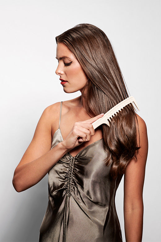 The Hair Edit White Tame & Condition Detangling Shower Comb For Wet & Dry Hair used by long haired brunette female model