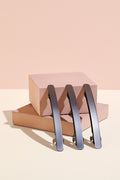 The Hair Edit black gunmetal brushed baguette metallic barrette display with pink backdrop