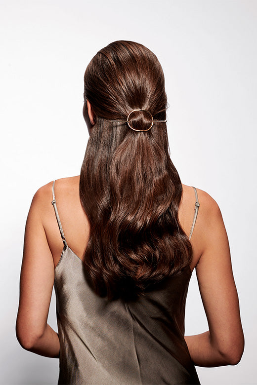 The Hair Edit Gold Hair Slide Hoop & Pin Two Piece Metal Loop Barrette styled in half up half down updo on long wavy haired brunette female model