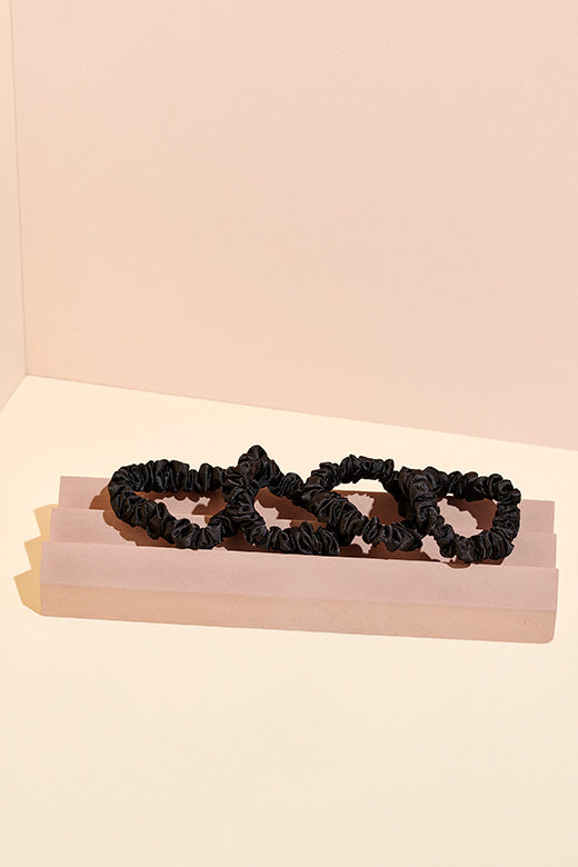 The Hair Edit skinny black ruched satin ribbon hair scrunchie accessories in set of 4 on display