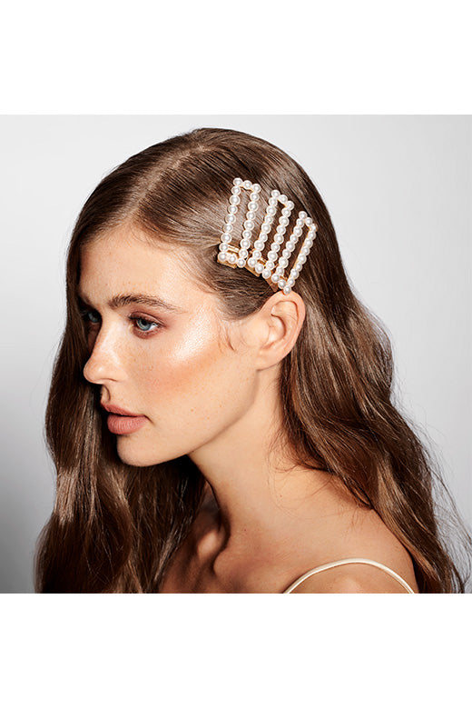 Blonde Female Wavy Long Haired Model wearing Three of The Hair Edit's Pearl Square Gold Jeweled Clip Hair Accessories Close-up