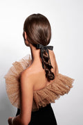 The Hair Edit black knotted ribbon scrunchie hair bow accessory worn by brunette female model with braided hairstyle