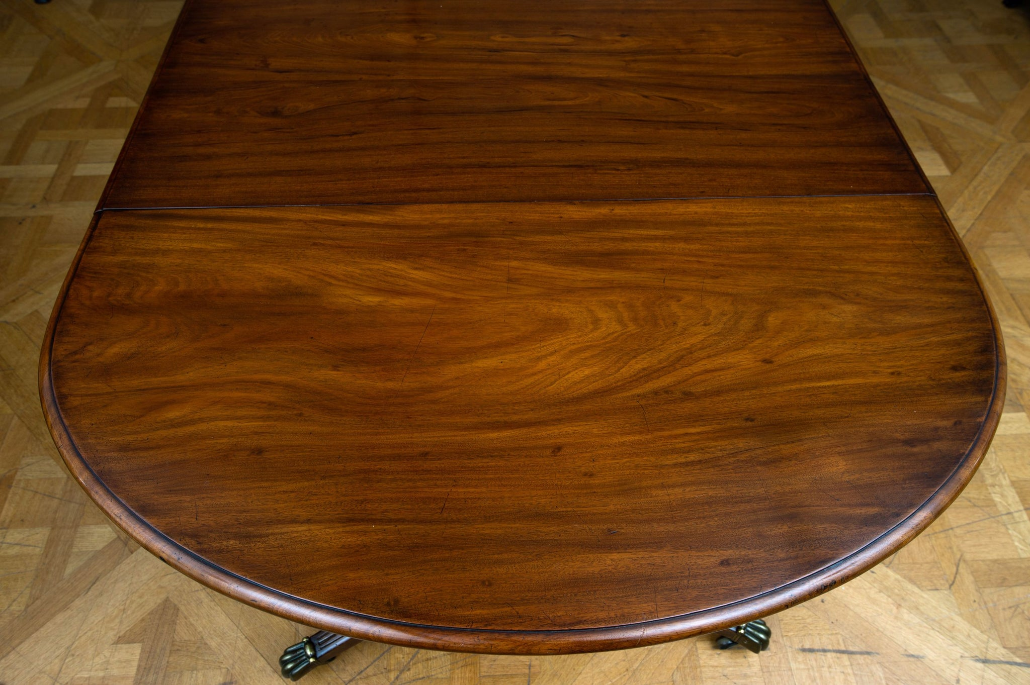 Late Regency Mahogany Three Pillar Dining Table
