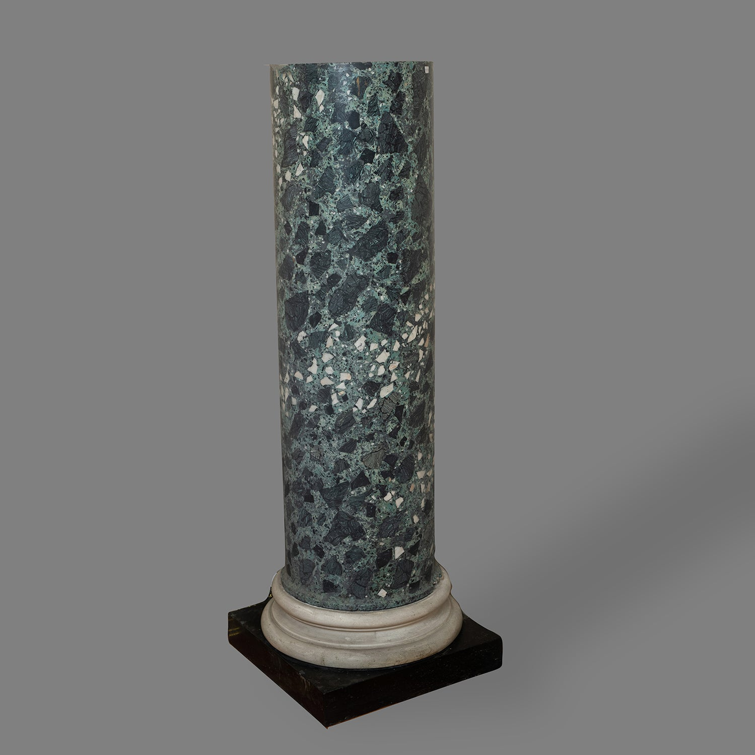 A VERDE-ANTICO SCAGLIOLA AND MARBLE COLUMN ON WHITE TURNED COLLAR SUPPORT AND BLACK MARBLE BASE