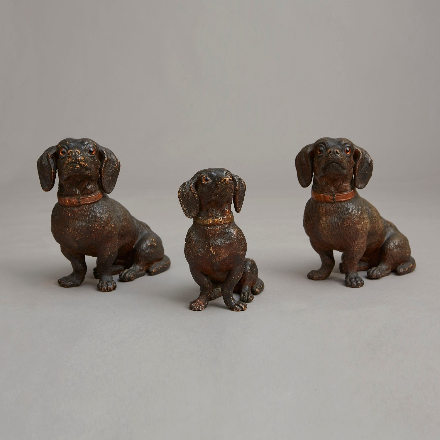 Collection of Terracotta Seated Dachshunds
