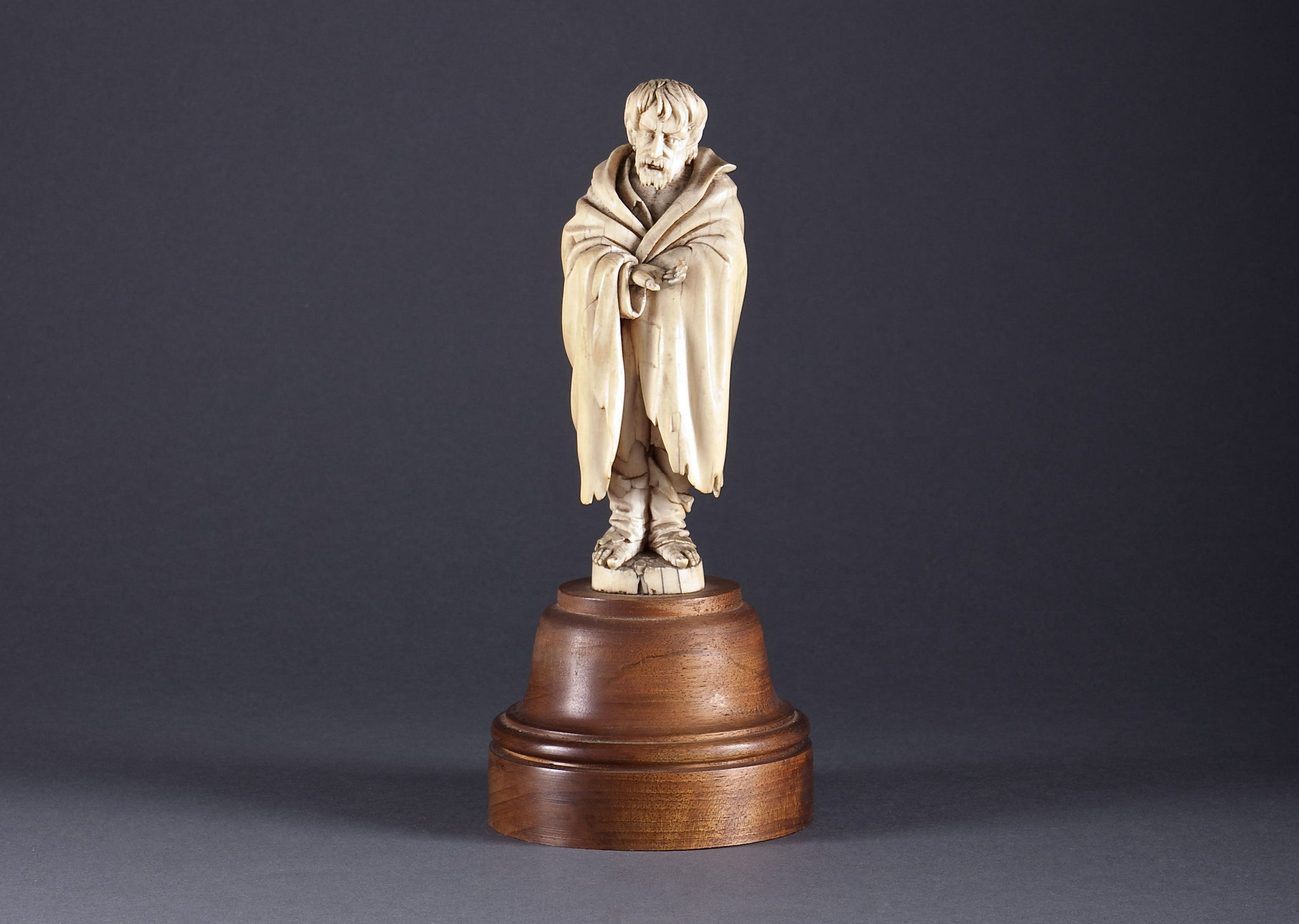 A Carved Ivory Figure of a Beggar