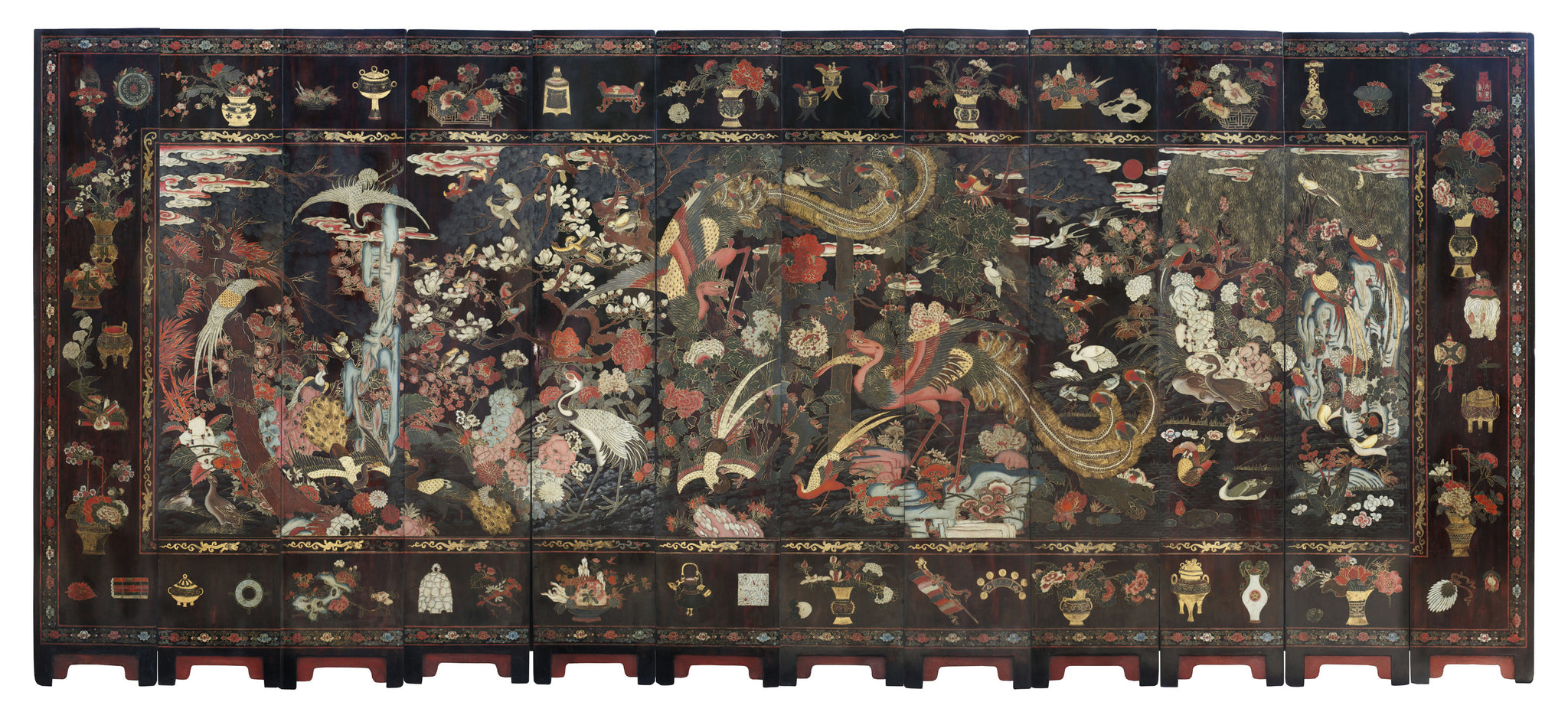 A RARE TWELVE PANEL POLYCHROME LACQUER SCREEN China,  Kangxi Period (1661-1722)  Early 18th Century