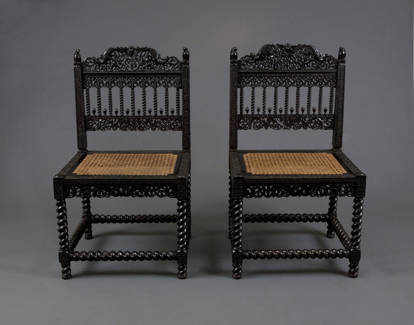 1.  A Pair Of Museum Quality Carved Ebony Chairs