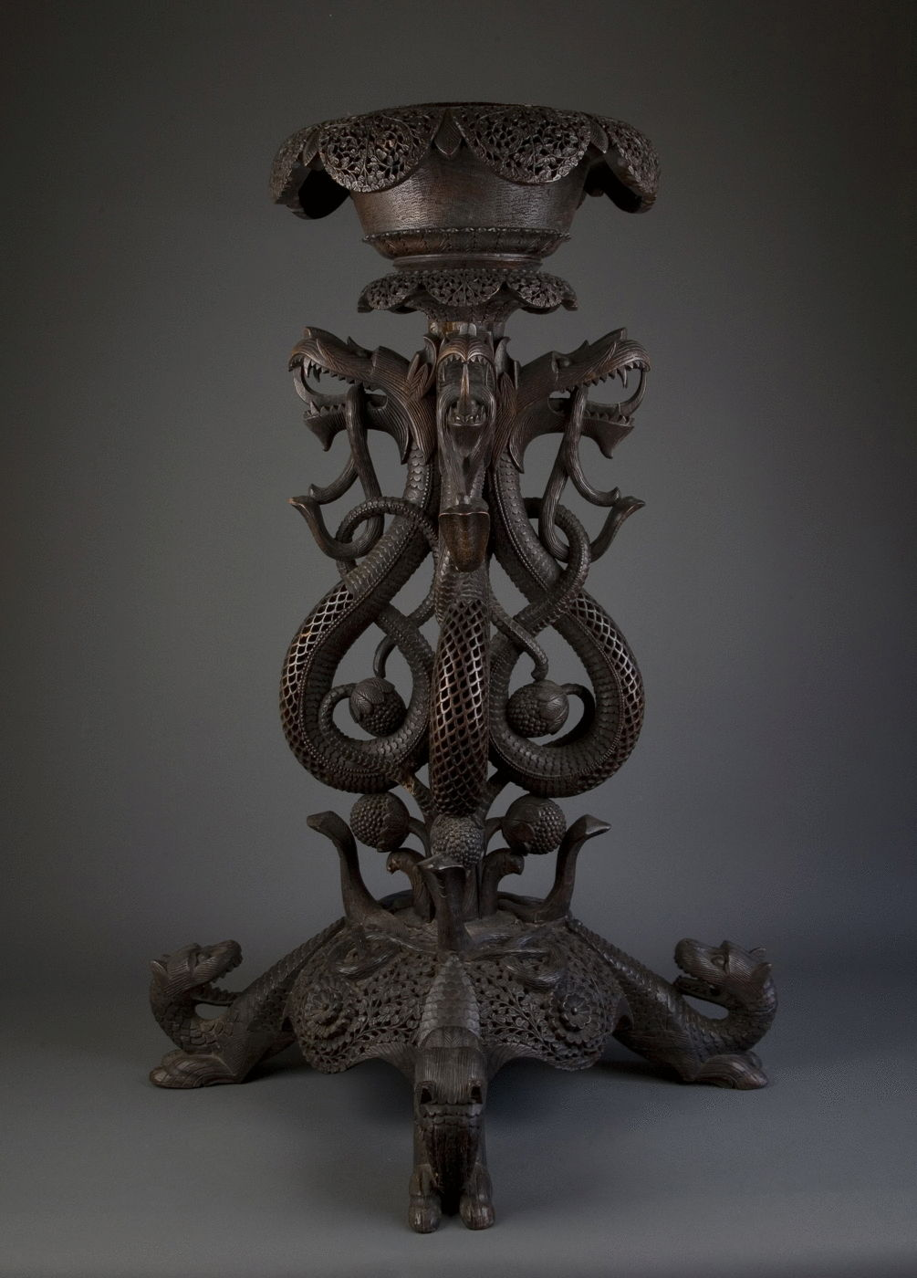 6.  A Carved Blackwood Plant Stand