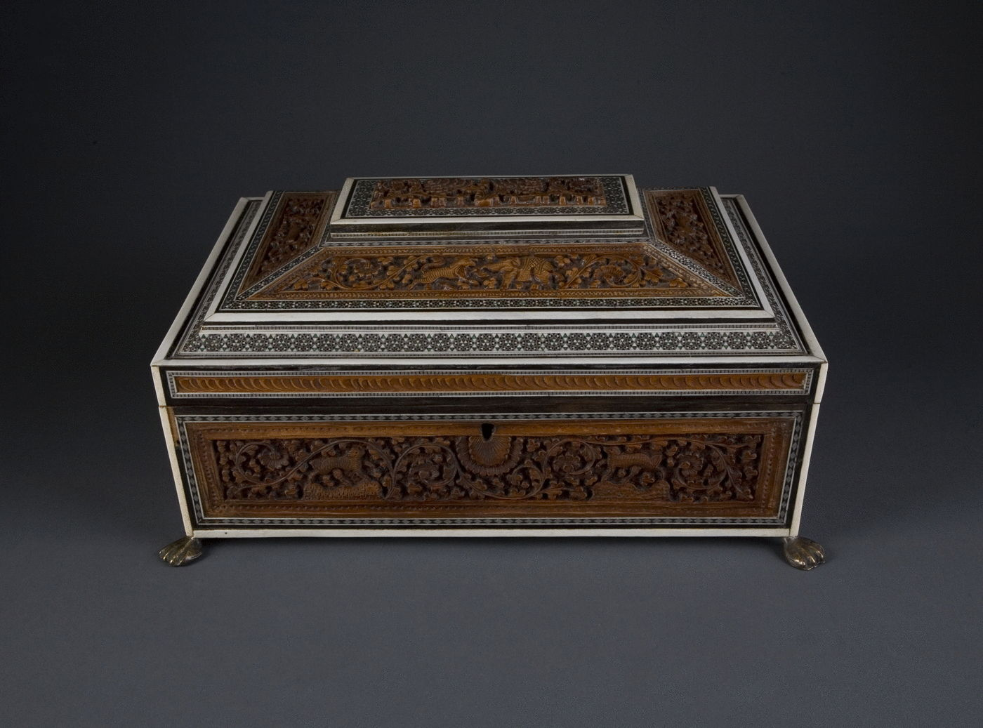 10.  A Carved Sandalwood and Sadeli Work Box