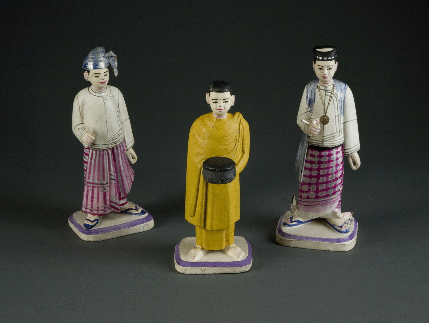 21.  Three Polychrome And Carved Wood Figures
