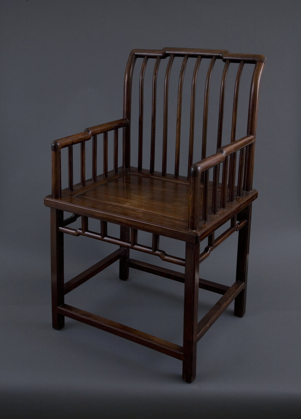27.  A Chinese Spindle Back Rose Chair