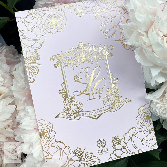 An Elegant Garden Baby Shower Invitation With A Custom Gold Crest