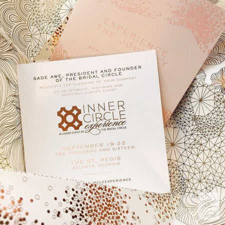 A Glamorous Origami Invitation With Rose Gold Patterning And Metal Embellishments
