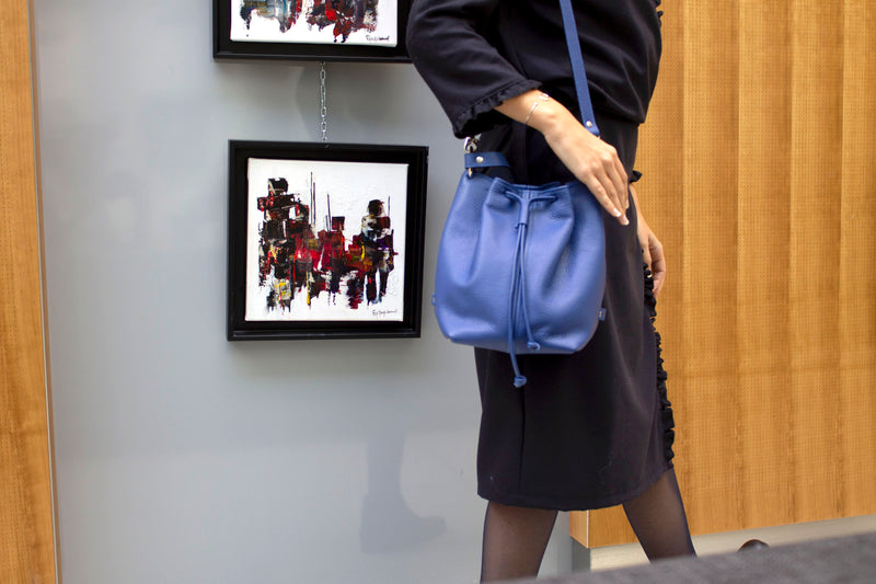 Model wearing a Leather bucket bag in blue