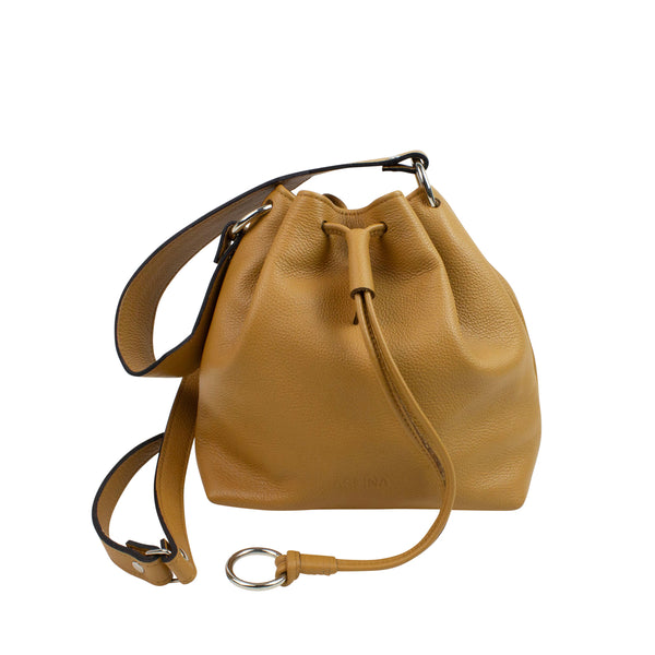 Leather bucket bag in tan color on a white background