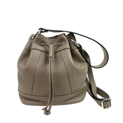 Leather bucket bag in taupe color on a white background