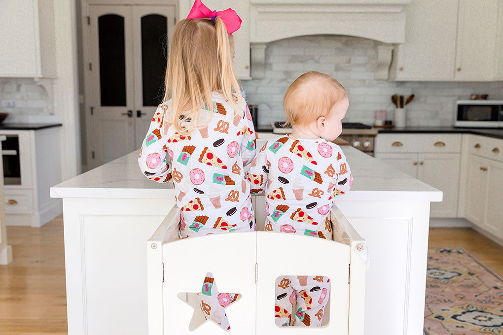 photo taken from behind with two toddlers enjoying their bamboo apparel