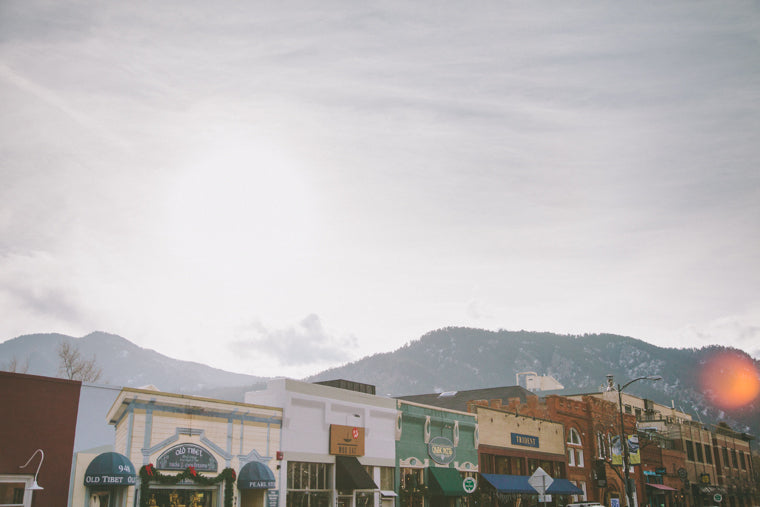 Photo of boulder shops with mountains