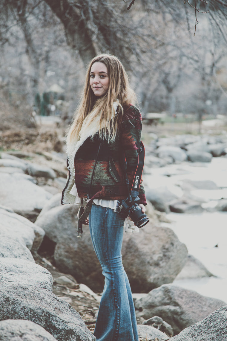 Photo of beautiful bohemian girl in rocks in boulder colorado