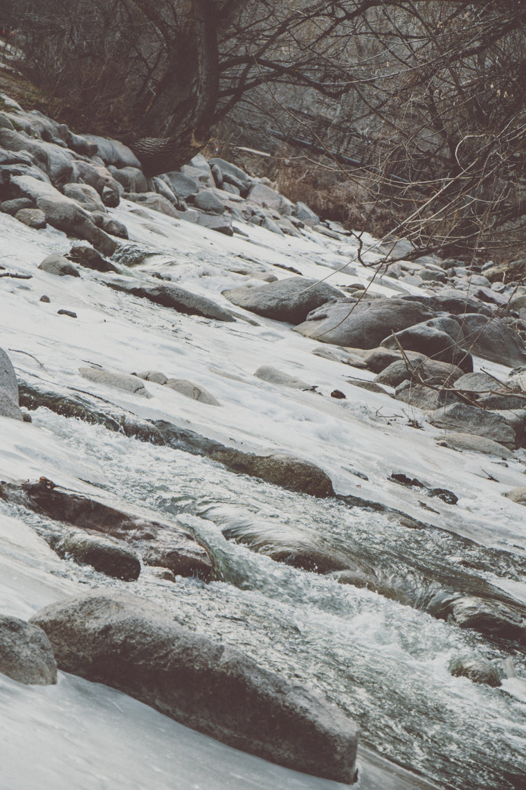 Photo of frozen river rapids in Boulder Colorado