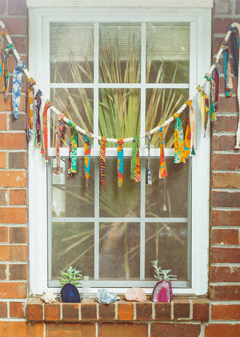Vintage kantha tassel fringe garland hanging in window by SoulMakes